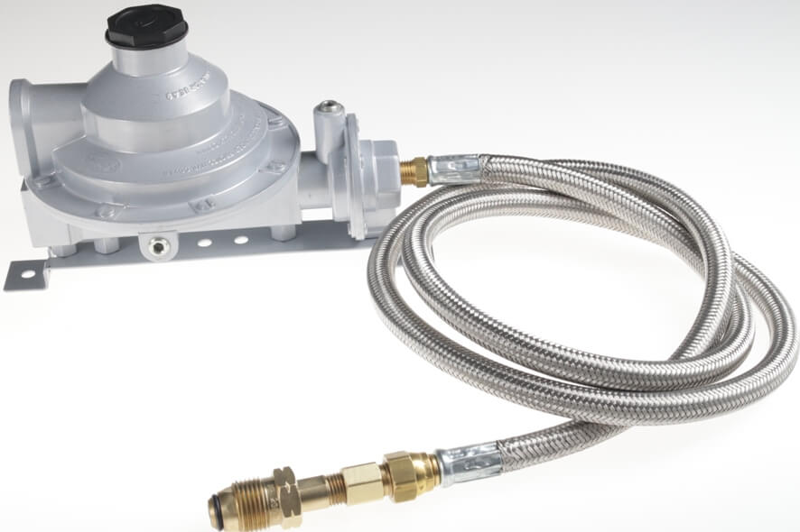 Twin Stage 525,000 btu/hr Low Pressure Regulator shown with 905       Universal Mounting Bracket and Optional Stainless Steel Overbraid Hose